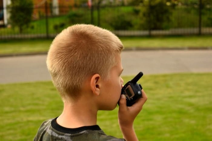 kid playing with a walkie talkie